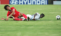 Ghana's David Addy (6) screams as his foot to twisted between the legs of South Korea's Young Cheol Cho (10) during the FIFA Under 20 World Cup Quarter-final match between Ghana and South Korea at the Mubarak Stadium  in Suez, Egypt, on October 09, 2009.