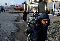 Pictured: A migrant man carries her young child on her back in Orestiada near the Greek-Turkish border. Sunday 01 March 2020<br /> Re: Clashes between migrants and riot police at the Greek-Turkish border of Kastanies near Evros, Greece