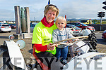 Paddy O'Donovan with his grandmother Maura O'Sullivan sitting on a David Brown tractor at the Blennerville Tractor Run Into the West fundraiser for Kerry Hospice on Sunday.