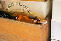 Sauternes wine bottles in a wooden crate and a carton case on top. Chateau de Cerons (Cérons) Sauternes Gironde Aquitaine France