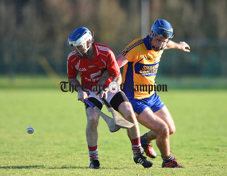 Pat Vaughan of Crusheen in action against Noel Purcell of Sixmilebridge during the Clare Champion Cup final in Shannon. Photograph by John Kelly.