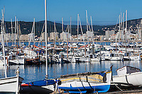 Harbor boats and city skyline, Palamos, Spain