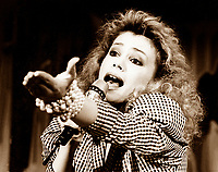 Frenc Canadian singer Martine Saint-Clair during a benefit telethon, November 30 1985<br /> <br /> n school, at 15, singing songs by Gino Vanelli and Jean-Pierre Ferland, her sister providing the piano accompaniment. She was noticed by Luc Plamondon who saw her perform excerpts from the rock opera Starmania at the 'Cégeps en spectacle' competition; he offered her the role of Crystal in the Quebec production that played at the Comédie nationale in Montreal in 1980 (recorded on Beaubec BB-106).<br /> <br /> She won a Félix Award as discovery of the year in 1981. Her first album, Coeur-ordinateur (1982, Pro-Culture PPC-6023) contained songs by Plamondon. It was followed by Il y a de l'amour dans l'air (1984, ADM International ADM-4001) which won her the Félix for pop LP of the year in 1985. With her third LP, Ce soir l'amour est dans tes yeux (1986, ADM International ADM-4004), which sold over 100 000 copies, she won Félix awards for pop song, best-selling single, pop LP and as female performer of the year in 1986. Her fourth album, Martine Saint-Clair (MJM International MJM-200), was launched in 1988. She starred in the second Paris production of Starmania, once again in the part of Crystal which she sang for over a year (this production was recorded on 2-WEA 24-42131 and Apache CD-44213). The anthology Mes plus belles chansons was released on the Star label (STR-CD-51) in 1988. Denis Lavoie wrote in (Montreal) La Presse: 'Discovered with Starmania, she entered our lives (...) for good with her shrill voice, her love cries, and songs that shot tenor times to the top of hit parades'.<br /> <br /> photo (c)  Images Distribution