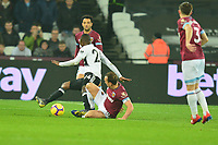 Mark Noble of West Ham United tackles Jean Michaël Seri of Fulham during West Ham United vs Fulham, Premier League Football at The London Stadium on 22nd February 2019
