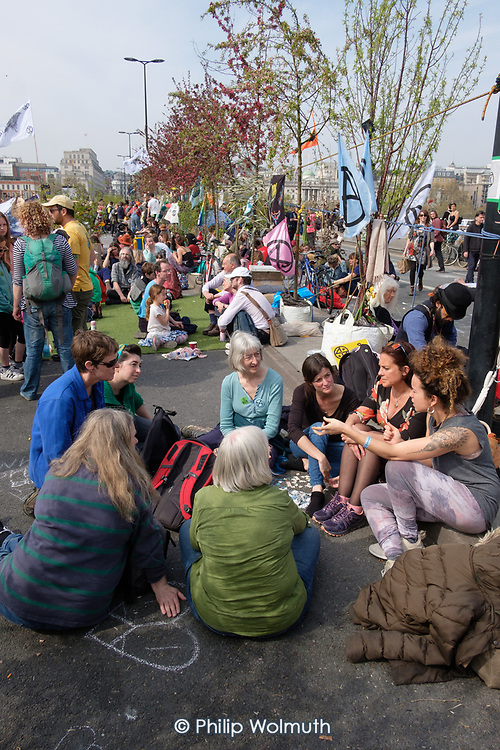 Discussion group.  Extinction Rebellion climate change campaigners occupy Waterloo Bridge, London.