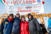 The three  Redington Brothers, Ryan, Robert and Ray Jr.  and their dad Raymie pose at the finish line in Nome during the 2017 Iditarod on Thursday March 16, 2017.<br /> <br /> Photo by Jeff Schultz/SchultzPhoto.com  (C) 2017  ALL RIGHTS RESERVED