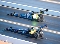 Nov 3, 2019; Las Vegas, NV, USA; NHRA top fuel driver Leah Pritchett (top) defeats Cameron Ferre during the Dodge Nationals at The Strip at Las Vegas Motor Speedway. Mandatory Credit: Mark J. Rebilas-USA TODAY Sports