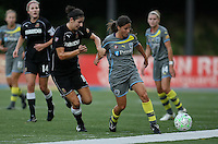 Philadelphia midfielder, Christina DiMartno (5) and Western New York midfielder, Yael Averbuch (19), grapple for the ball.  Philadelphia stayed on top of the table with a 2-1 victory over the Western New York Flash on July 9th at Widener University in Chester, PA.