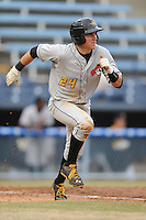 West Virginia Power catcher Reese McGuire #24 runs to first during game one of a double header against the Asheville Tourists at McCormick Field on April 8, 2014 in Asheville, North Carolina. The Power defeated the Tourists 6-5. (Tony Farlow/Four Seam Images)