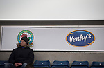 Blackburn Rovers 3 Shrewsbury Town 1, 14/01/2018. Ewood Park, League One. A home supporter sitting in the Jack Walker Stand next to a an advertising sign for owners Venkey's before Blackburn Rovers played Shrewsbury Town in a Sky Bet League One fixture at Ewood Park. Both team were in the top three in the division at the start of the game. Blackburn won the match by 3 goals to 1, watched by a crowd of 13,579. Photo by Colin McPherson.
