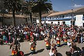 Paucartambo, Peru. Masked dancers with crowds watching at the Fiesta de la Virgen del Carmen.