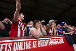 Home supporters watching the action from the Ealing Road terrace as Brentford hosted Leeds United in an EFL Championship match at Griffin Park. Formed in 1889, Brentford have played their home games at Griffin Park since 1904, but are moving to a new purpose-built stadium nearby. The home team won this match by 2-0 watched by a crowd of 11,580.
