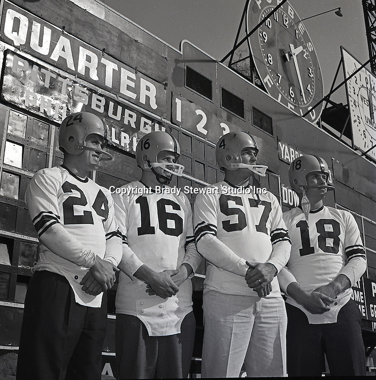 Pittsburgh PA:  Pittsburgh Steelers posing for a Public Relations photoshoot at Forbes Field.  Len Dawson #16, Ted Marchibroda #18, Billy Wells #24 & Ed Beatty #57 - the Oakland section of Pittsburgh