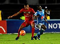 BOGOTA - COLOMBIA - 09 – 05 - 2017: Duvier Riascos (Der.) jugador de Millonarios disputa el balón con Julian Millan (Izq.) jugador de Cortulua, durante partido de la fecha 17 entre Millonarios y por la Liga Aguila I-2017, jugado en el estadio Nemesio Camacho El Campin de la ciudad de Bogota. / Duvier Riascos (R) player of Millonarios vies for the ball with Julian Millan (L) player of Cortulua, during a match of the date 17th between Millonarios and Cortulua, for the Liga Aguila I-2017 played at the Nemesio Camacho El Campin Stadium in Bogota city, Photo: VizzorImage / Luis Ramirez / Staff.