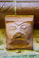 Norman Romanesque exterior corbel no 56 - sculpture of a stylised head of a human. The Norman Romanesque Church of St Mary and St David, Kilpeck Herefordshire, England. Built around 1140
