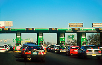 Urban traffic at toll booth, NJ, Philadelphia, PA