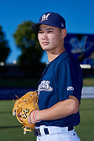 AZL Brewers Blue Lun Zhao (15) poses for a photo before an Arizona League game against the AZL Athletics Gold on July 2, 2019 at American Family Fields of Phoenix in Phoenix, Arizona. AZL Athletics Gold defeated the AZL Brewers Blue 11-8. (Zachary Lucy/Four Seam Images)