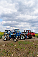 BNPS.co.uk (01202) 558833. <br /> Pic: Cheffins/BNPS<br /> <br /> Pictured (from left): A Ford 7000 sold for £34,840, a 1983 County 1474 £210,112 and a 1974 Massey Ferguson 1200 sold for 27,872. <br /> The top selling lot was a 1983 County 1474 (PICTURED CENTRE) which has done less than 100 hours in the past 25 years. It fetched £210,100<br /> <br /> A farming family is today celebrating after their incredible collection of almost 100 vintage tractors sold for a staggering £1million.<br /> <br /> Father and son duo Ian and Martin Liddell began hoarding the agricultural vehicles at their arable farm in the 1980s.<br /> <br /> Their fleet of tractors was so large that they had to be stored in three barns.<br /> <br /> The prized collection sparked a worldwide bidding war when it was sold with auctioneers Cheffins, of Cambridge, after the family decided to part with the tractors to free up space on their Essex farm to pursue other projects.
