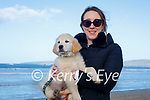 Colm the dog being taken for a walk by Emer McDonnell in Banna beach on Sunday.
