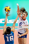 Middle blocker Irina Zaryazhko of Russia (R) spikes the ball during the FIVB Volleyball World Grand Prix match between Serbia vs Russia on July 21, 2017 in Hong Kong, China. Photo by Marcio Rodrigo Machado / Power Sport Images