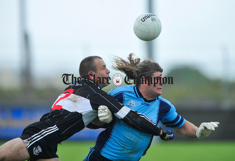 Doonbeg's Padraig Gallagher clashes with Noel Morrisey of Cooraclare. Photograph by Declan Monaghan