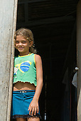 Pará State, Brazil. Altamira. Girl in a Brazil flag t-shirt.