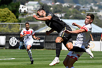 Rory McKeown of Team Wellington competes for the ball with Regont Murati of Waitakere United during the ISPS Handa Men's Premiership - Team Wellington v Waitakere Utd at David Farrington Park,Wellington on Saturday 30 January 2021.<br /> Copyright photo: Masanori Udagawa /  www.photosport.nz