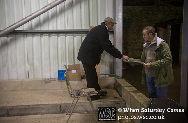 Belper Town v Gresley, 28/01/2014. Christchurch meadow, Northern Premier League. A spectator buying a programme before Belper Town's match against Gresley, in a Northern Premier League, first division south fixture at Christchurch meadow. The home side have played at their current ground since the club was reformed in 1951. Belper won this fixture against their local Derbyshire rivals by 4 goals to 1 watched by a crowd of 165 spectators. Photo by Colin McPherson.
