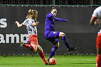 Corina Luijks (14) of Zulte-Waregem pictured shooting towards goal in front of Britt Vanhamel (4) of Anderlecht during a female soccer game between RSC Anderlecht Dames and SV Zulte Waregem on the 10 th matchday of the 2020 - 2021 season of Belgian Womens Super League , friday 18 th of December 2020  in Tubize , Belgium . PHOTO SPORTPIX.BE | SPP | DAVID CATRY
