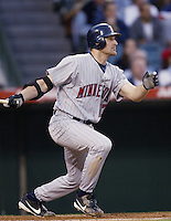 Corey Koskie of the Minnesota Twins bats during a 2002 MLB season game against the Los Angeles Angels at Angel Stadium, in Anaheim, California. (Larry Goren/Four Seam Images)