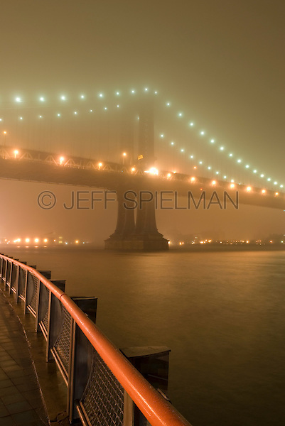 AVAILABLE FROM JEFF AS A FINE ART PRINT.<br /> <br /> AVAILABLE FROM PLAINPICTURE FOR COMMERCIAL  AND EDITORIAL LICENSING.  Please go to www.plainpicture.com and search for image # p5690056.<br /> <br /> Manhattan Bridge and East River on a Foggy Night, Viewed from the East River Esplanade, Lower Manhattan, New York City, New York State, USA