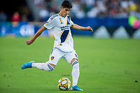 CARSON, CA - SEPTEMBER 29: Uriel Antuna #18 of the Los Angeles Galaxy crosses a ball during a game between Vancouver Whitecaps and Los Angeles Galaxy at Dignity Health Sports Park on September 29, 2019 in Carson, California.
