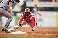 Batavia Muckdogs third baseman Javier Lopez (23) slides head first into third during a game against the Brooklyn Cyclones on July 6, 2016 at Dwyer Stadium in Batavia, New York.  Batavia defeated Brooklyn 15-2.  (Mike Janes/Four Seam Images)