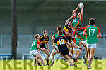 Colin McGillycuddy, Mid Kerry goes highest over Mark O'Shea, Dr. Crokes during the Kerry County Senior Football Championship Semi-Final match between Mid Kerry and Dr Crokes at Austin Stack Park in Tralee, Kerry.