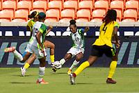 HOUSTON, TX - JUNE 10: Francisca Ordega #17 of Nigeria crosses the ball during a game between Nigeria and Jamaica at BBVA Stadium on June 10, 2021 in Houston, Texas.