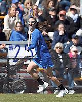 Duke University midfielder Erin Tenneson (11) brings the ball forward. Boston College (white) defeated Duke University (blue), 10-9, on the Newton Campus Lacrosse Field at Boston College, on April 6, 2013.