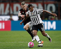 Calcio, Serie A: Milan vs Juventus. Milano, stadio San Siro, 9 aprile 2016. <br /> Juventus' Alex Sandro, right, is challenged by AC Milan's Juraj Kucka during the Italian Serie A football match between AC Milan and Juventus at Milan's San Siro stadium, 9 April 2016.<br /> UPDATE IMAGES PRESS/Isabella Bonotto