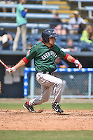 Greenville Drive second baseman Carlos Asuaje #20 swings at a pitch during a game against the  Asheville Tourists at McCormick Field on May 18, 2014 in Asheville, North Carolina. The Tourists defeated the Drive 3-1. (Tony Farlow/Four Seam Images)