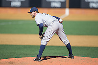 Georgetown Hoyas relief pitcher David Ellingson (5) looks to his catcher for the sign against the Bucknell Bison at Wake Forest Baseball Park on February 14, 2015 in Winston-Salem, North Carolina.  The Hoyas defeated the Bison 8-5.  (Brian Westerholt/Four Seam Images)