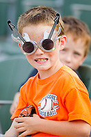 A young fan shows off his rock and roll sunglasses at Fieldcrest Cannon Stadium on July 16, 2011 in Kannapolis, North Carolina.  The Intimidators defeated the BlueClaws 5-3.   (Brian Westerholt / Four Seam Images)