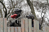 Pictured: Ashley Williams (L) with fellow fighter on top of the adventure park castle. Tuesday 25 January 2011<br /> Re: Swansea City FC footballers and staff have spend a morning at Teamforce Paintball in Llangyfelach near Swansea south Wales.