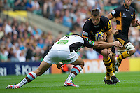 Tom Lindsay of London Wasps is tackled by Nick Easter of Harlequins during the Aviva Premiership match between London Wasps and Harlequins at Twickenham on Saturday 1st September 2012 (Photo by Rob Munro).