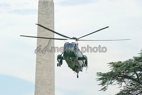 Marine One, with United States President Barack Obama, aboard, prepares to land on the South Lawn of the White House in Washington, D.C. following the President's tour of the National Hurricane Center in Miami on Thursday, May 28, 2015.<br /> Photo Credit: Ron Sachs/CNP/AdMedia