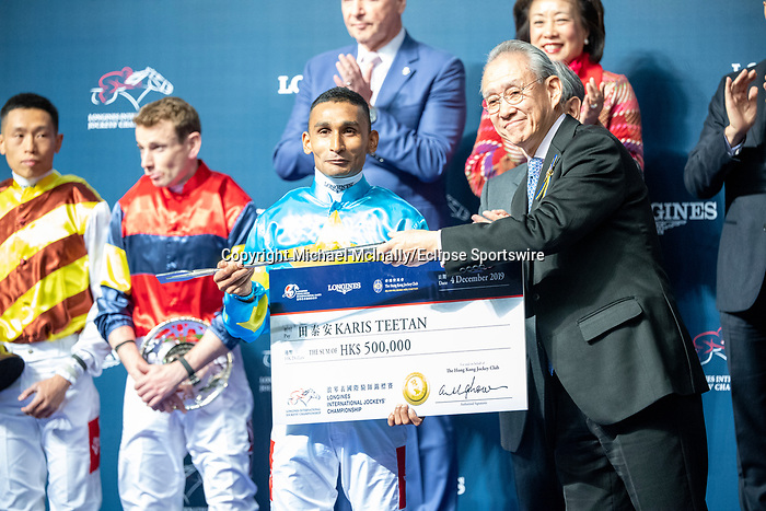 Happy Valley, Hong Kong - December 4:Karis Teetan winning the Longines International Jockey' Championship at Happy Valley Racecourse in Hong Kong. Michael McInally/Eclipse Sportswire/CSM