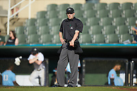 Home plate umpire Matt Baldwin between innings of the South Atlantic League game between the Hickory Crawdads and the Kannapolis Intimidators at Kannapolis Intimidators Stadium on May 6, 2019 in Kannapolis, North Carolina. The Crawdads defeated the Intimidators 2-1 in game one of a double-header. (Brian Westerholt/Four Seam Images)