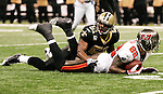 December 2009: New Orleans Saints linebacker Jonathan Vilma (51) tackles Tampa Bay Buccaneers tight end Kellen Winslow (82) during an NFL football game at the Louisiana Superdome in New Orleans.