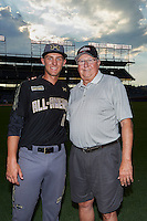 Grae Kessinger (11) of Oxford High School in Oxford, Mississippi poses for a photo with his grandfather Don Kessinger, a former member of the Chicago Cubs, St. Louis Cardinals, and Chicago White Sox, after the Under Armour All-American Game on August 15, 2015 at Wrigley Field in Chicago, Illinois. (Mike Janes/Four Seam Images)