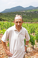 Sylvain Fadat Domaine d'Aupilhac. Montpeyroux. Languedoc. Les Cocalieres recently planted magnificent vineyard plot on the hill slope. Owner winemaker. France. Europe. Vineyard. Mountains in the background. Mont Saint Baudille.
