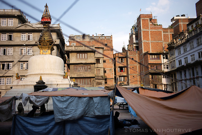 A woman is seen under a shelter made of tarps at Yetkha Bahal, an area of Kathmandu where homes were made unsafe by the earthquake in Kathmandu, Nepal in June 2015.