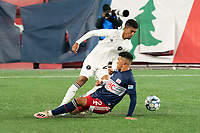 FOXBOROUGH, MA - OCTOBER 09: Christian Lue #20 of Fort Lauderdale CF avoids a slide tackle by Damian Rivera #72 of New England Revolution II during a game between Fort Lauderdale CF and New England Revolution II at Gillette Stadium on October 09, 2020 in Foxborough, Massachusetts.